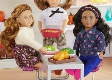 Three dolls having dinner.