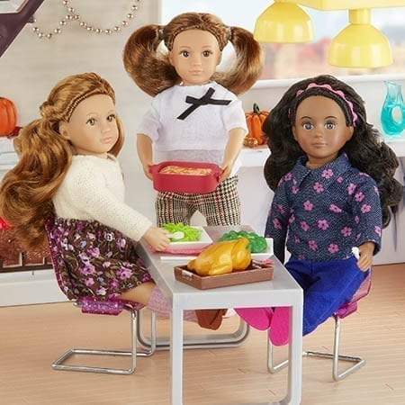 Three dolls having dinner.