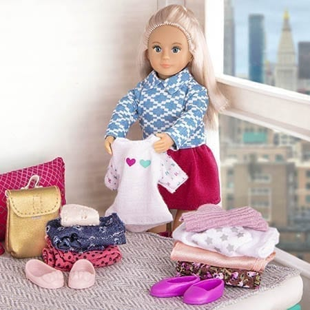 Doll folding clothes.