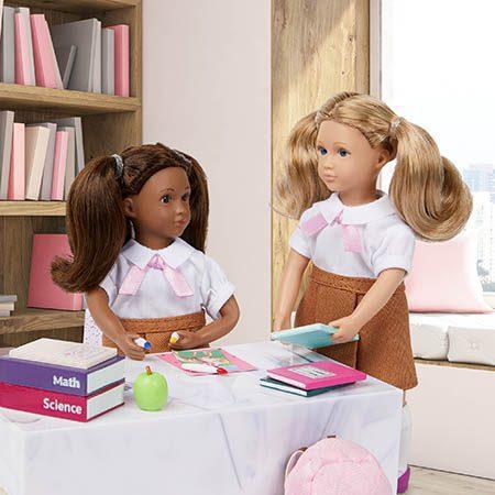 Two student dolls in school.