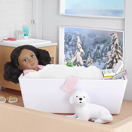 Mini doll in tub.