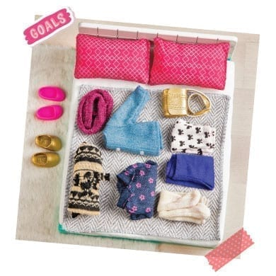 Doll clothes on a toy bed.