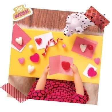 Doll making Valentines Day cards.