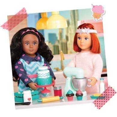 Two dolls baking.