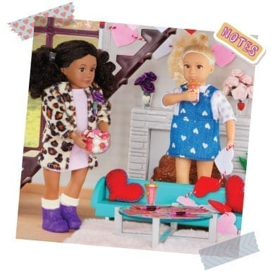Two dolls making Valentines day crafts.