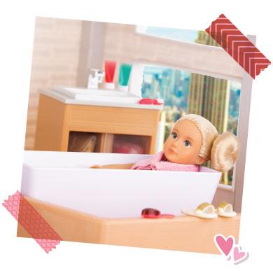 Mini doll in tub.