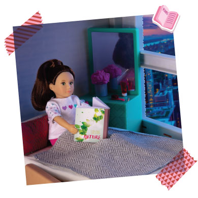 Mini doll reading book.