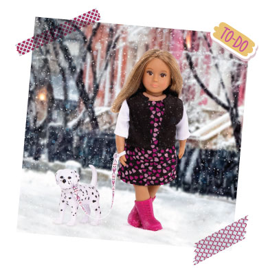 Mini doll with toy dalmatian.