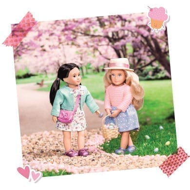 Two dolls with Easter egg baskets.