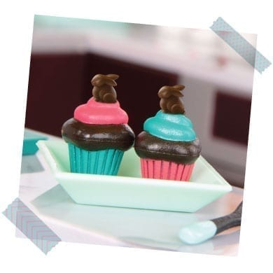 Toy cupcakes with bunny toppers.