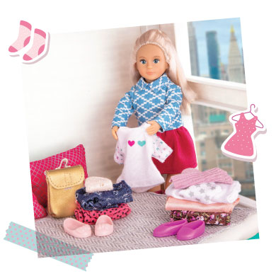 Mini doll sorting clothes.