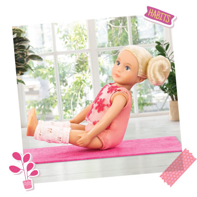 Mini doll doing yoga.